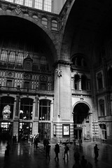 STATION TO STATION (natascha_huls) Tags: street city travel people urban blackandwhite bw streets building travelling history classic monochrome station vertical architecture contrast train buildings grey blackwhite construction europe cityscape publictransportation floor belgium noiretblanc interior crowd streetphotography streetlife trainstation historical antwerp interiordesign depth peoplewatching classy publicplace
