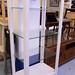 Tall slim wood framed display unit