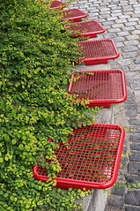 Happy Bright Red Bench Monday! (suzanne.gibson) Tags: red public bench munich bush outdoor seat
