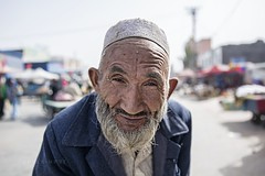 Hotan 631 (PEOPLEIMEET) Tags: life china street old travel people man fruit race portraits beard photography one shanghai faces respect time retrato no tiger muslim islam border chinese beijing streetphotography spit hotan uighur xinjiang kashgar zodiac  uyghur wisdom tradition stories skyward region wrinkles ritratto cina humans arrogance portre  portrat gabor disrespect  streetportraits  onerace  potret noborders hony   peopleimeet peopleinchina oldfaces  humansofnewyork humansof humansofchina humansofshanghai humansofbeijing