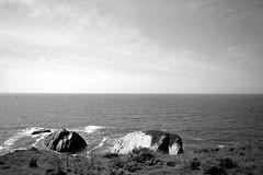 The beautiful coatline (Sazzaheaton) Tags: sea sky white black nature grass contrast coast rocks waves horizon calming calm ongoing sparkling
