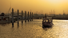 Late Afternoon at the Marina (Press L) (Charn High ISO Low IQ) Tags: creek marina golden boat dubai 85mm abra lightandshadow lateafternoon waterview festivalcity canon6d skylinne