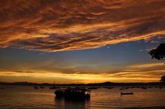 crazy (Ruby Ferreira ®) Tags: sunset sky clouds boats bay barcos branches silhouettes hills pôrdosol nuvens galhos montanhas baía silhuetas santoantoniodelisboa brasilemimagens