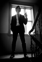 The man in the staircase (Thomas Grotmol) Tags: blackandwhite white man black sunglasses oslo norway stairs dark norge smoke eerie suit staircase 17mai sigar may17th