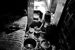 Facing one's own (shankarsarkar) Tags: india home cooking blackwhite women mother dailylife kolkata westbengal sonagachi redlightarea trafficked