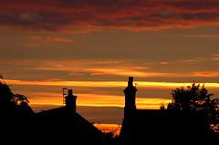 House chimneys in sunset light (Kirkleyjohn) Tags: sunset sky cloud sun silhouette atardecer evening suffolk sonnenuntergang pôrdosol sunsetlight chimneys eveninglight lowestoft coucherdusoleil