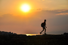 Walk under the setting sun () Tags: travel sunset sun sports sunshine silhouette walking photography hope cambodia southeastasia purple cloudy hiking religion young radiation sunsets angkorwat backpacking rights sunsetglow angkor forward sealevel khmersmile anddignity