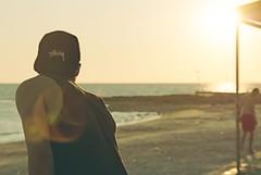 Disfruta el silencio (*BeckyBecky*) Tags: sunset sea sky italy sun beach colors person sunny playa cap silence enjoy