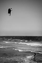 Edge of freedom (Howard Sandford) Tags: sea blackandwhite bw kite monochrome surf waves wind horizon kook kitesurfing edge pismobeach bnw kitesurfer