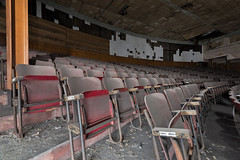 Fifty shades of red (Behind The Signs) Tags: abandoned theater exploring ngc seats disused dust socialism fiftyshades behindthesigns
