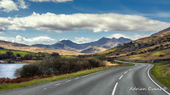 The Winding Road (Adrian Evans Photography) Tags: road uk camping trees summer sky sunlight mountain lake mountains green nature water lines stone wales clouds farmhouse river landscape tents highway rocks day shadows outdoor ripple hill landmark snowdon coastline british watersedge welsh snowdonia riverbank hdr conwy scenics gwynedd cribgoch windingroad northwales capelcurig llynnaumymbyr snowdonianationalpark snowdonsummit snowdonhorseshoe a4086 adrianevans lynnaumymbyr snowdonmassif dyffrynmymbyr mymbyrlake