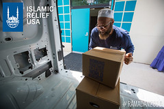 The Imam of the masjid helps unload Ramadan food boxes to distribute at a mosque in Baltimore