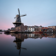 The Pride of Haarlem (McQuaide Photography) Tags: city longexposure light urban holland reflection building haarlem water netherlands windmill spaarne dutch skyline architecture zeiss river square outside licht spring twilight lowlight europe waterfront outdoor dusk availablelight sony tripod nederland peaceful wideangle 11 calm nd fullframe alpha 16mm tranquil waterside squarecrop stad molen manfrotto noordholland gebouw schemering c1 rivier wideanglelens ndfilter 1635mm northholland a7ii groothoek phaseone neutraldensity variotessar captureone mirrorless nd18 molendeadriaan sonyzeiss bwfilters 6stop scheepmakerskwartier mcquaidephotography ilce7m2 captureonepro9