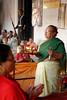 Prières (Bertrand de Camaret) Tags: nepal bertranddecamaret kathmandu katmandou durbarsquare femme woman priere cloche bell lampeahuile nationalgeographic ngc vertical soldat militaire