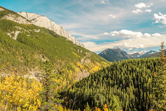 Beginning of Autumn. (ian.emerson36) Tags: autumn trees sky canada mountains tree green fall yellow clouds landscape rockies colours seasons september alberta