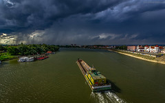 Storm ahead! (pexart foto) Tags: storm clouds river boat ship cloudy cargo