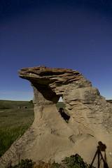 Hollow Hoodoo (John Andersen (JPAndersen images)) Tags: night stars sandstone alberta moonlight hoodoo geology