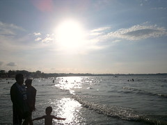 Under the Sun (Joseph Basto) Tags: sunset sea reflection nokia shore seashore