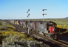 Southern Pacific 8299 WB Manifest W. of Gallinas NM (Railblazer) Tags: southernpacific southernpacificrailroad southernpacificrailway sp sprailroad southernpacifictucumcariline sptucumcariline southernpacificgoldenstateroute spgoldenstateroute goldenstateroute southernpacificfreighttrain southernpacifictrain spfreighttrain sptrain emd emdsd40t2 sd40t2 sd40t2locomotive emdsd40t2locomotive semaphoresignal southernpacificsemaphoresignal spsemaphoresignal stylebsemaphoresignal stylebsignal spstylebsemaphoresignal southernpacificstylebsemaphoresignal southernpacificlowerquadrantsemaphore splowerquadrantsemaphore lowerquadrantsemaphore lowerquadrantsemaphoresignal