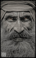 Sikh Dude (A B H | Photography) Tags: old portrait people india man detail eye face canon temple golden eyes indian kerala punjab hindu emotions wrinkle amritsar goldentemple punjabi editorschoice abh incredibleindia canon60d abhphotography
