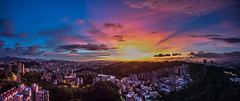 Gift from the Storm  (Sharleen Chao) Tags: longexposure sunset urban panorama color horizontal skyline canon landscape cityscape cloudy taiwan nopeople 101  taipei taipei101  afterglow 101 capitalcity 1635mm anticrepuscularrays    cloudfire canoneos5dmarkiii
