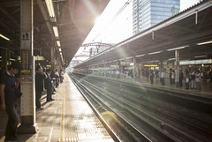 Busy Train station (G.A.I.N) Tags: people station japan train lens tokyo tracks sunny busy flare bussle hussle