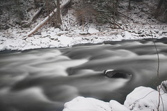 The rapids rushing by at McConnells Mill State Park (Dave DiCello) Tags: winter snow ice coveredbridge mcconnellsmill longexposures ndfilter neutraldensityfilter mcconnellsmillstatepark winterinpa davedicello coveredbridgeatmcconnellsmill bridgesinthesnow snowatmcconnellsmill coveredbridgeinthesnow mcconnellsmillinthewinter
