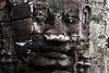 Least undamaged smiling face bottom left view at the Bayon Temple (Patumraat) Tags: thailand temple ancient asia cambodia ruin empire siem thom civilization angkor wat invasion asean ayudhaya reab khmehr