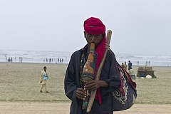 snake charmer on the beach.. (camelot98.) Tags: ocean leica pakistan sea portrait color colour beach 50mm seaside sand colorful asia dof streetphotography streetportrait rangefinder karachi m9 arabiansea blinkagain