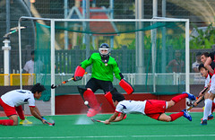Japanese player takes a desperate dive shot at goal (sergelynx) Tags: hockey fihworldhockey2015