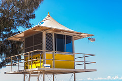 Lifeguard Hut At The City Of Gold Coast (k009034) Tags: travel shadow sky people building tree window nature yellow outdoors gold coast bucket wire no space branches australia nopeople lifeguard clear hut speaker queensland copyspace copy idyllic clearsky goldcoast destinations traveldestinations 500px teamcanon