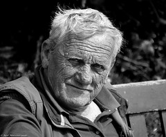When I was a young lad. (Neil. Moralee) Tags: street old uk light portrait people white man black eye beer monochrome loss face hair nose mono big eyes chair nikon dad sitting close natural zoom drink outdoor candid father grandfather neil stroke health devon mature age depression stare bulbous stress wrinkles apnea anxiety drinkers medication greyscale mental ageing memmory 18300mm d7100 moralee neilmoralee beerdevonnikond7100neilmoralee