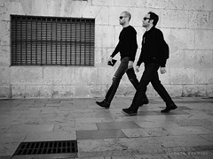 Men in Black...in sync (RichardK2010) Tags: street mono candid alicante reservoirdogs synched meninblack instep 17mm olympuspenf snapseed