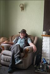 Ray at home (Garry Corbett) Tags: portrait green hat chair lifestyle lounging homesweethome colourportrait bluejazzbuddha heartattacksurvivor raytheranger cgarrycorbett2016 rayathome newhealthregime portraitofrayleech
