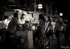 Waiting for ice cream (gunman47) Tags: street b people bw white black ice monochrome field sepia night asian photography 50mm mono eyes singapore waiting asia thought bokeh f14 candid albert w cream deep tourist east changer stop bubble shallow moment cart friday sg depth seller act decisive seah streetside