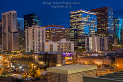 Close-Up of Downtown Denver Skyscrapers from Lower Downtown at Night (Bridget Calip - Alluring Images) Tags: morning travel sunset skyline architecture sunrise buildings evening colorado cityscape exterior skyscrapers outdoor dusk denver crime rockymountains blueskies civiccenter allrightsreserved metalandglass queencity copyrighted greentrees 2016 denverbroncos capitalcity capitalcities dramaticclouds highclouds denvercityandcountybuilding milehighcity denverskyline downtowndistrict buildingcomplex vacationdestination cityclouds batmanshooting capitalofcolorado centennialstate queencityoftheplains bridgetcalip alluringimages marijuanalegal milehicity alluringimagesllc 5280abovesealevel