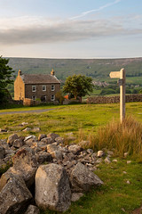 Harkerside, Swaledale (matrobinsonphoto) Tags: sunset summer house building sign rural landscape outdoors golden evening countryside rocks post farm yorkshire north rocky valley hour signpost dales swaledale reeth