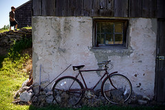 (Sean Anderson Media) Tags: stilllife bicycle barn vintage 50mm farm f14 country retro foundation oldbuilding oldwood doorcounty barnyard woodshingles lensadapter oldstone nikon50mmf14 fotodiox raleighsports nikontosonyemount sonyaa7rii
