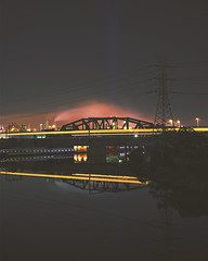cold nights. (lucidddreamin') Tags: bridge urban cold reflection night train reflections river nightlights smoke trains nighttime lighttrails lighttrail coldnight
