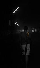 Day Done (relishedmonkey) Tags: lighting street light india man colour yellow shirt night umbrella 35mm person nikon moody darkness kerala midnight late dim selective mundu 18g d5300