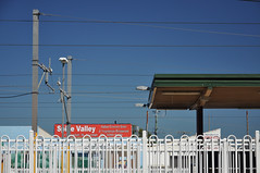 DSC_8444 [ps] - Sie Valley (Anyhoo) Tags: blue red station sign writing wire text platform railway australia bluesky brisbane line railwaystation qld queensland lettering railing canopy overhead catenary nundah anyhoo photobyanyhoo