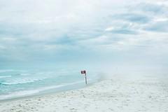Rumo à Patagônia (Raquel Pellicano) Tags: blue sea brazil praia beach riodejaneiro mar flag arraialdocabo