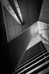 Bounded Aspiration (StefanB) Tags: california longexposure sky bw motion reflection glass monochrome architecture clouds sanjose headquarters adobe repetition geotag 2013 em5 1235mm flvonmirikr