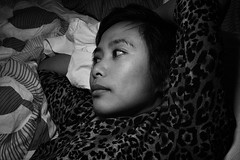 Anna in her hideous synthetic animal print top that she just loves for no apparent reason (newplasticmachine) Tags: portrait blackandwhite casual filipina recline chill