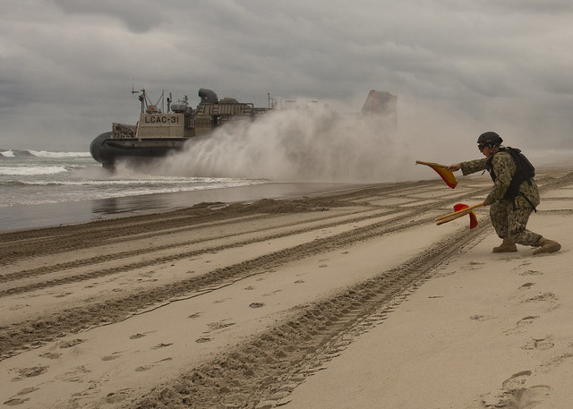 Sailor signals to an LCAC at Camp Pendleton.