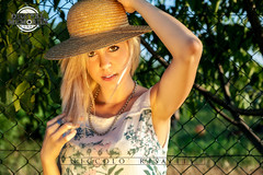 Straw Hat Girl at Sunset (Nik 5) Tags: sunset portrait sun white black color face field hat canon pose photography reflex model eyes panel sundown straw posing pic blonde flare hay bales onlocation