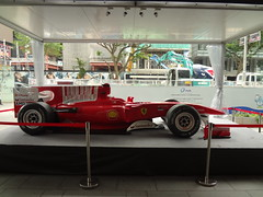Formula One car on display at Orchard Road (gunman47) Tags: road red car night race shopping one belt singapore district shell grand f1 ferrari orchard tourist racing prix worlds only formula sg santander sponsor gp attraction