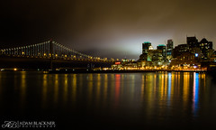 Alone in the Glowing Night (Adam Blackner Photography) Tags: city bridge sky reflection water night canon rebel oakland bay san francisco long exposure scape t3i
