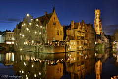 Rozenhoedkaai (JdJ Photography (www.jdj-photography.nl)) Tags: longexposure bridge people reflection tree tower wet water caf architecture bar night buildings mirror evening canal pub europa europe belgium bell drink nacht toren spiegel country brugge belgi nat flags tourists boom belfry westvlaanderen land lamps bluehour innercity brug drinken avond region continent bel province architectuur belfort gracht flanders lampen mensen regio reflectie gebouwen benelux vlaggen vlaanderen gewest toeristen binnenstad provincie rozenhoedkaai langesluitertijd blauweuur