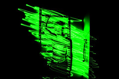(Miln Auman) Tags: light black green dark paint neon darkness bright flash fineart artsy laser lightpaint